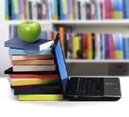 10998104-libros-y-un-ordenador-port-til
